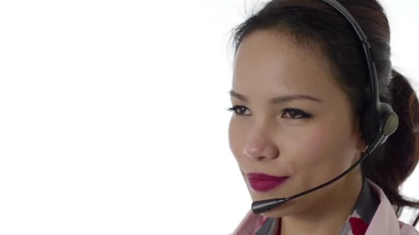 Asian woman working as call center operator with headphones