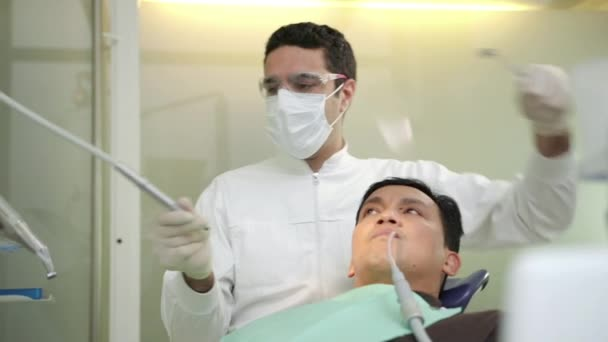 Doctor working as dentist, visiting patient in dental studio