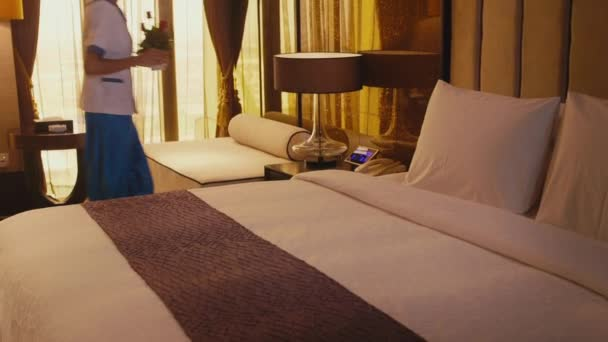 Asian housemaid cleaning hotel room