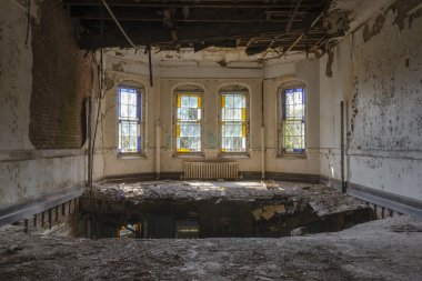 Hole in floor near four beautiful Vintage windows