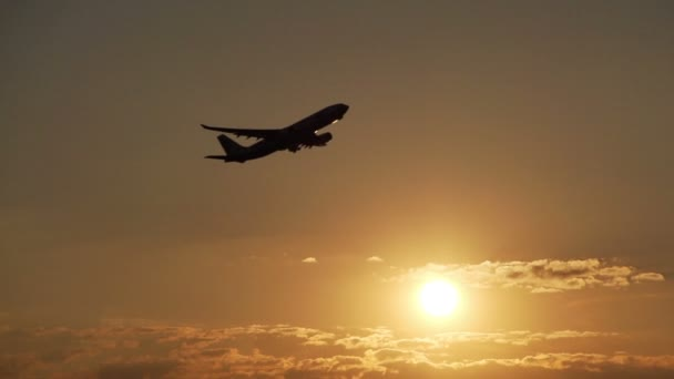 Aircraft take off at sunset
