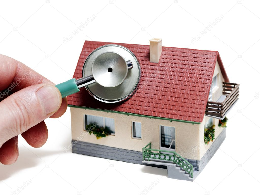 House diagnostics. Model house with hand and stethoscope