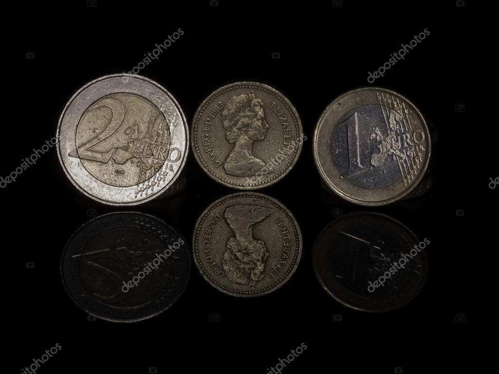 Euro And Pound Coins Stock Photo