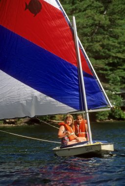 Young Girls in a Sailboat At Summer Camp
