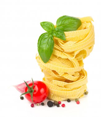 Italian food - pasta, tomatoes, basil, garlic and pepper