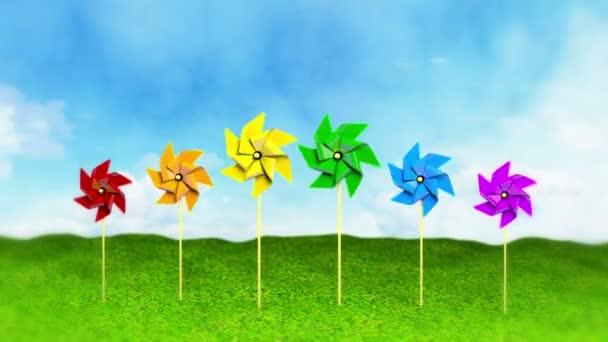 duha barevné rotující pinwheels na trávě