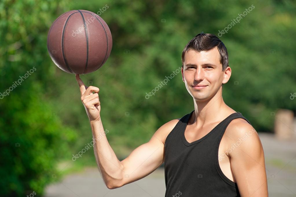 Young basketball player outdoors