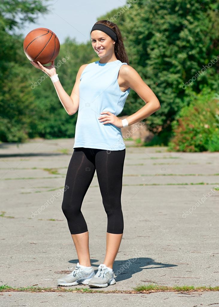 Young athlete with basketball