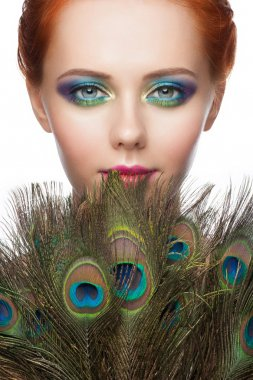 Woman with colorful peacock makeup