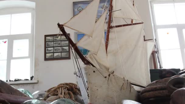 An old ship model with some rusty things on the side