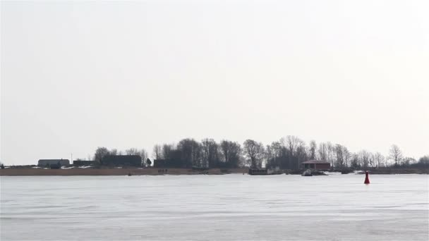 A view of an area with snow and a moving boat