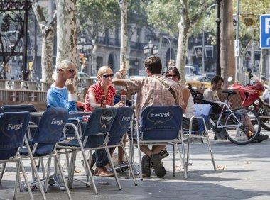 Men and women at outdoors restaurant in barcelona spain