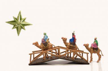three wisemen crossing a bridge