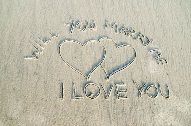 Love and text on sand