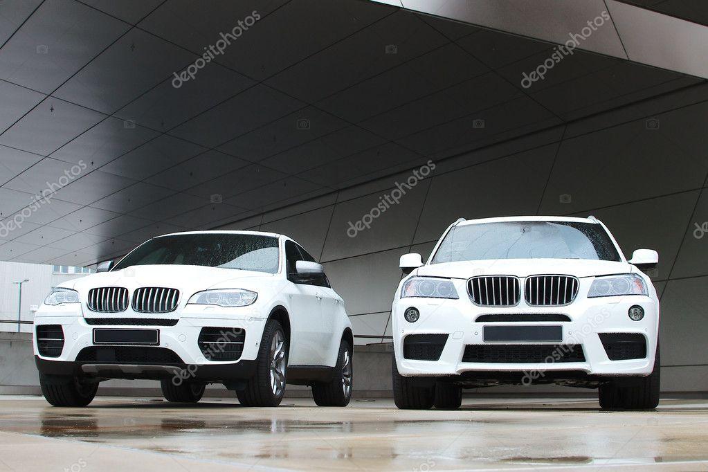 Two new white BMW X-series auto