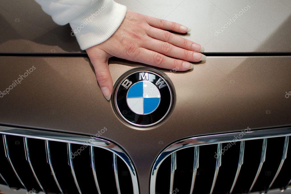 Woman's hand on BMW logo