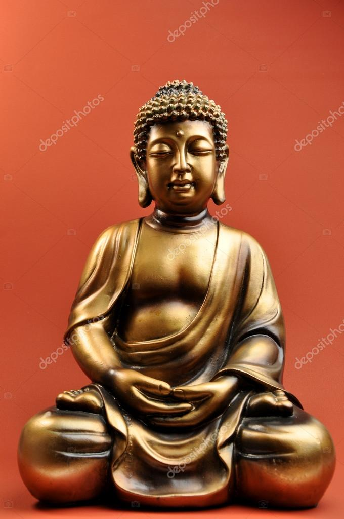 Bronze Buddha Statue Against a Red Orange Background