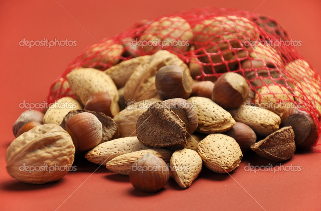 Healthy Food - Nuts on a Terra-cotta Background with Shallow DOf