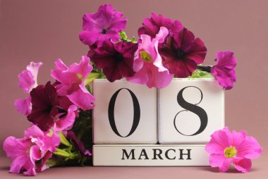 White block calendar for International Women's Day, March 8, decorated with pink and purple flowers (horizontal)