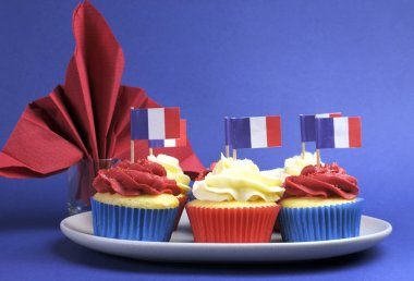 French theme red, white and blue mini cupcake cakes with flags of Franc