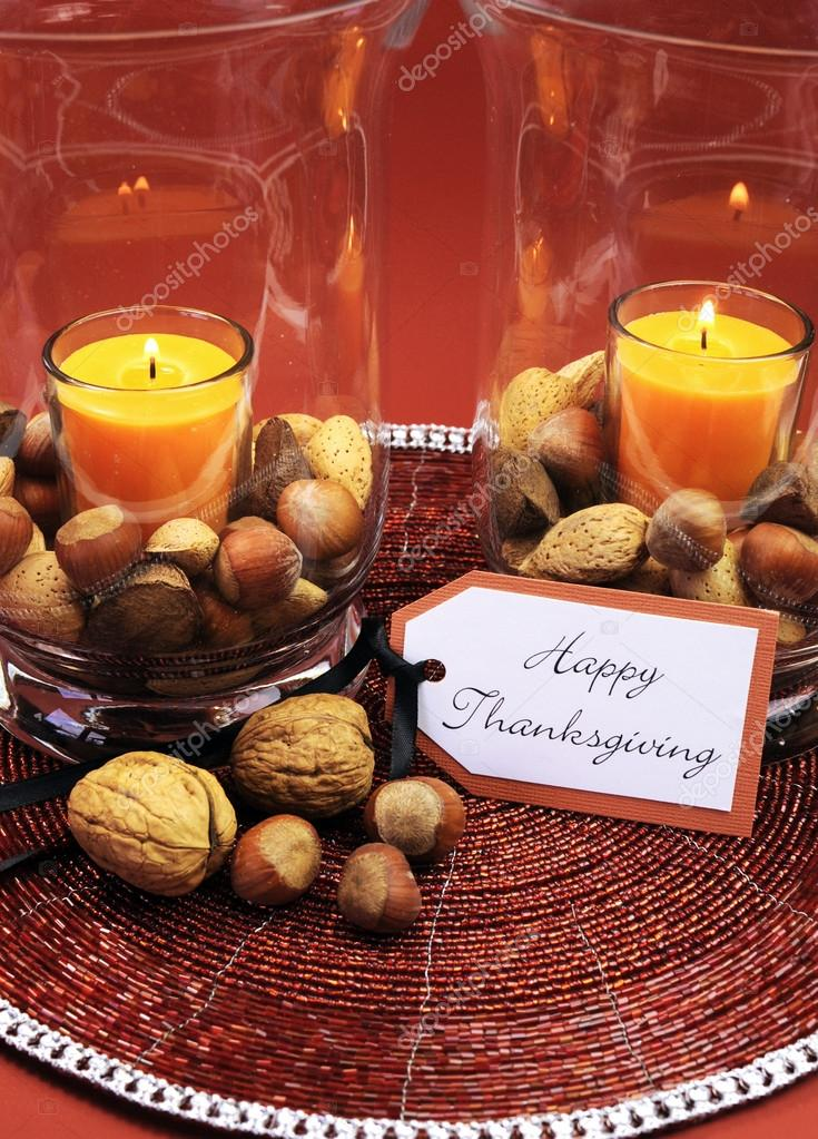 Beautiful Happy Thanksgiving table setting centerpiece with ornage candle and nuts in decorative glass hurrican l& vase and autumn arrangement Vertical. & Happy Thanksgiving table setting centerpiece. \u2014 Stock Photo ...