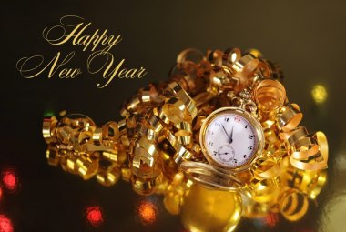 Gold pocket fob watch ready for midnight on New Years Eve