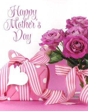 Beautiful pink gift roses on pink and white background