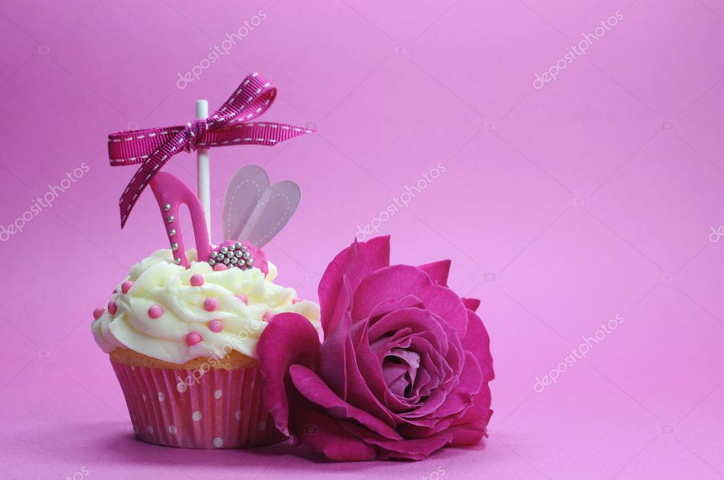 Beautiful decorated and colorful cupcake, one for each day of the week.