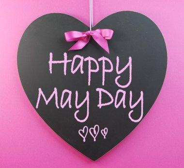 Happy May Day handwriting greeting on heart shaped blackboard
