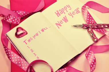 Happy New Year resolutions in diary jounrnal book with pretty fe