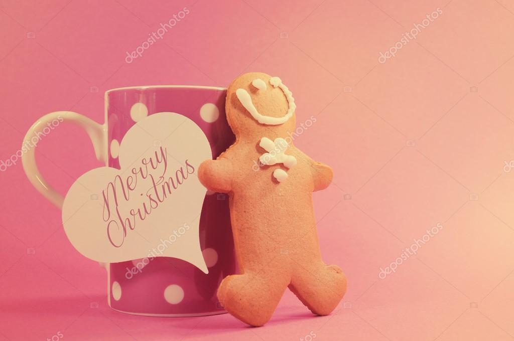 Frohe Weihnachten-Ingwer Brot Mann mit rosa Polka-Dot-Tasse coff ...