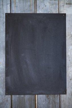 Vertical blackboard on an old fence background