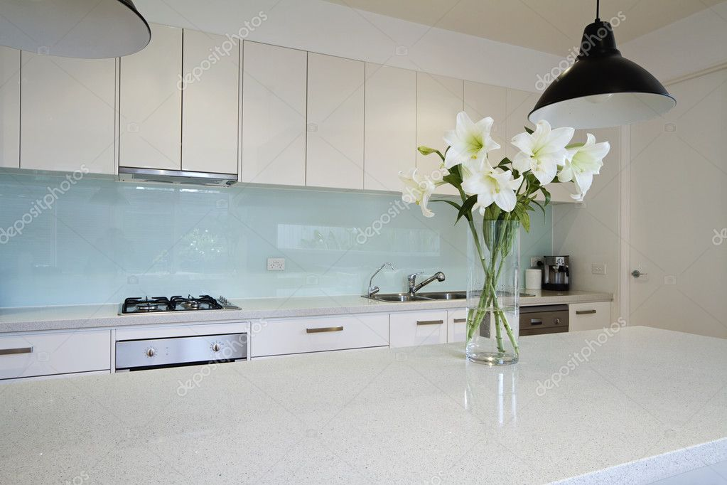 Flowers on contemporary kitchen bench