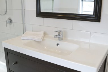 Black bathroom vanity and mirror