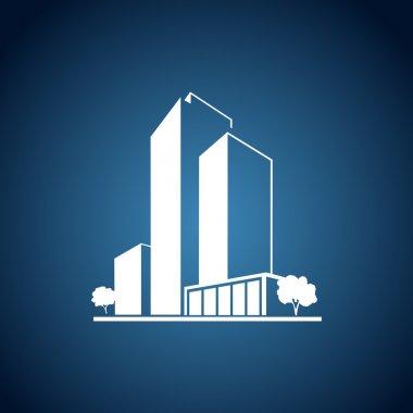 Beyaz apartmanlar mavi fonda