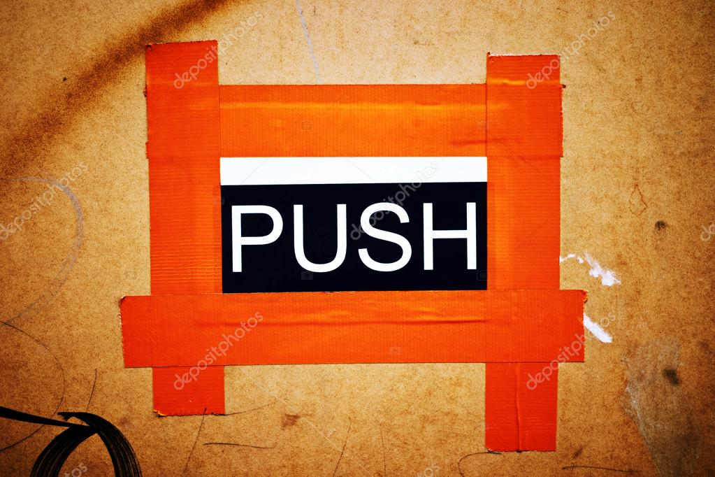 A makeshift PUSH door sign stuck to a chip board door with orange gaffer tape. u2014 Photo by sspice & Makeshift Orange PUSH Door Sign u2014 Stock Photo © sspice #14683395 pezcame.com