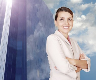 Successful businesswoman on the business center and sky backgrou