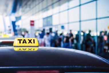 Taxi sign on car
