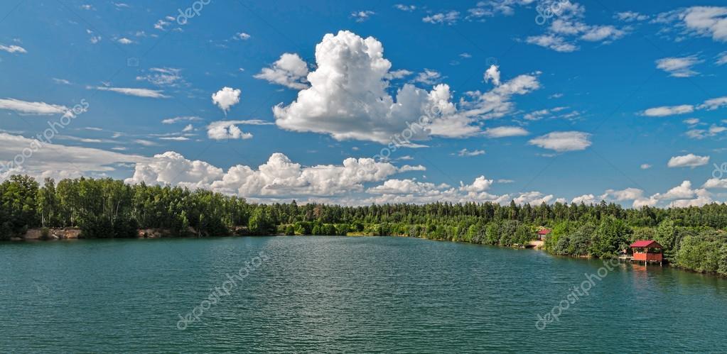 Lake amidst beautiful clouds.