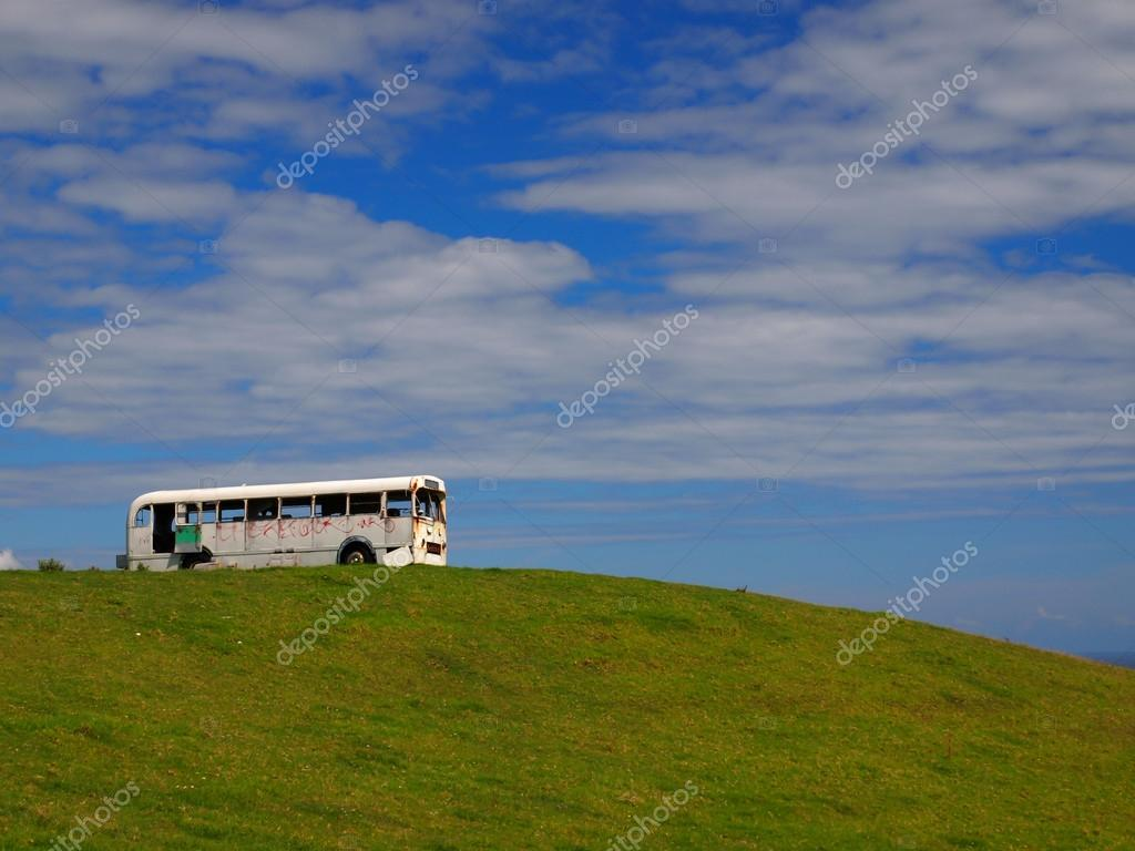 old school bus on hilltop