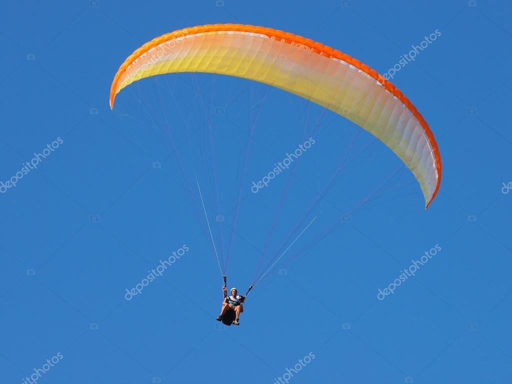 Tandem parachute in blue sky