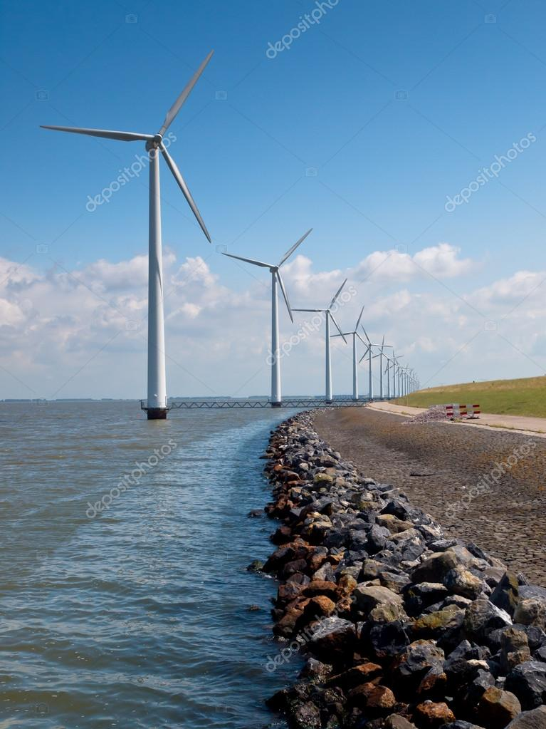 Row of wind turbines along the coast