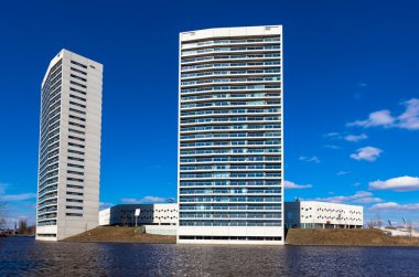 White Apartment Towers at the Water Front with Blue Sky