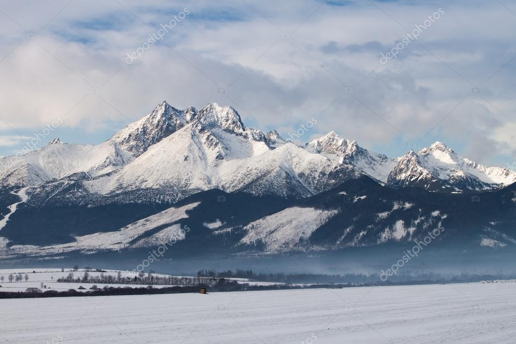 View of mountain peaks and snow in winter time, High Tatras