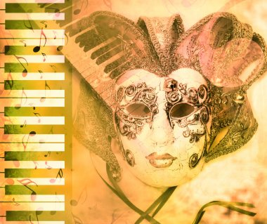 Venice mask and piano keyboard on grunge background.