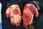 Fotografie Womans hands with henna tattoo