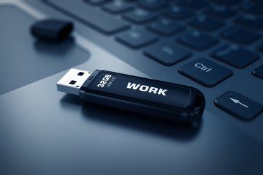 Modern USB Flash drive on laptop keyboard
