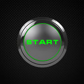 Photo Green LED start button on black background.