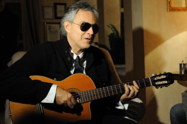 Andrea Bocelli playing guitar