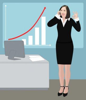 Success business woman shows ok sign